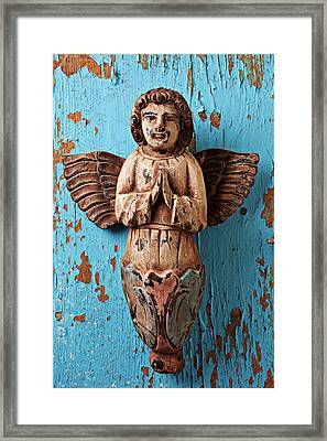 Angel On Blue Wooden Wall Framed Print by Garry Gay