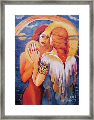 Angel Touch Framed Print