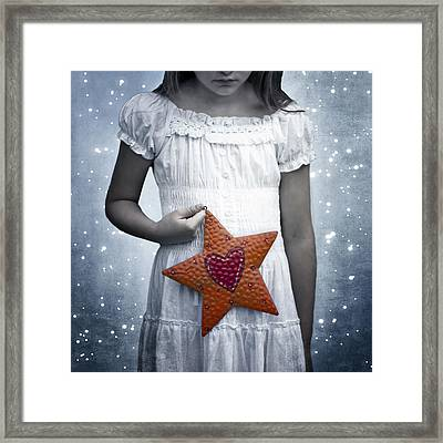 Angel With A Star Framed Print by Joana Kruse