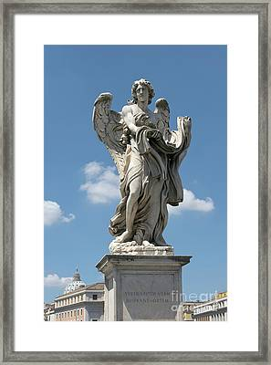 Angel With The Garment And Dice Framed Print