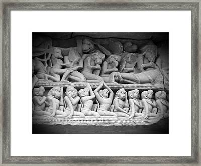 Angkor Carvings Framed Print by Ian Scholan
