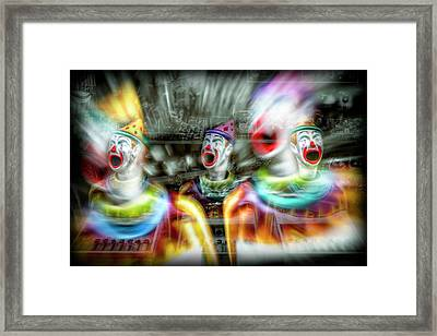 Framed Print featuring the photograph Angry Clowns by Wayne Sherriff