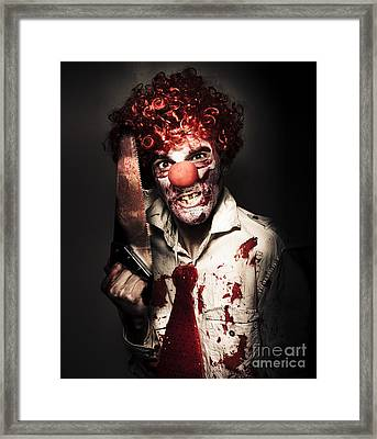 Angry Horror Clown Holding Butcher Saw In Darkness Framed Print by Jorgo Photography - Wall Art Gallery