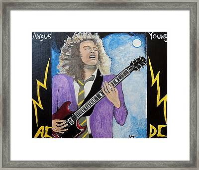 Angus Young Forever. Framed Print by Ken Zabel