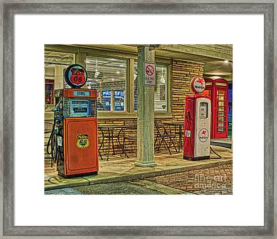Antique Gas Pumps Framed Print