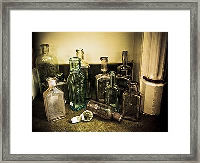 Antique Glass Bottles Framed Print