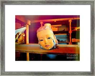 Antique Mannequin Head In Old Storage Room Framed Print