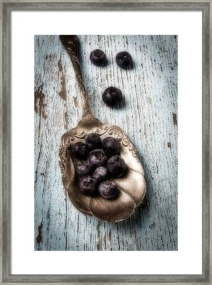 Antique Spoon And Buleberries Framed Print