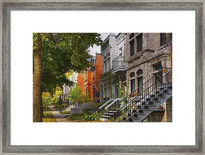 Apartment Buildings Along City Street Framed Print