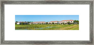Apartment Buildings In North Port Framed Print by Panoramic Images
