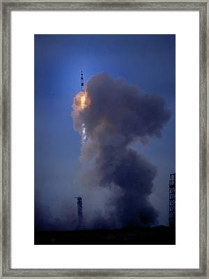 Apollo 11 Begins Its Flight To The Moon Framed Print by O. Louis Mazzatenta