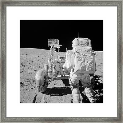 Apollo 16 Astronaut Reaches For Tools Framed Print by Stocktrek Images