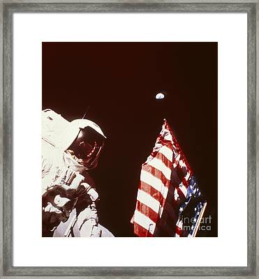 Apollo 17 Astronaut On Moon With Flag Framed Print by NASA / Science Source