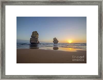 Apostles Sunset Framed Print by Ray Warren