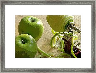Apples Getting Peeled Framed Print