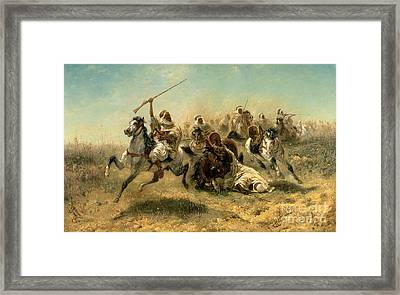 Arab Horsemen On The Attack Framed Print by Adolf Schreyer