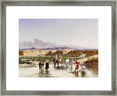 Arab Horsemen Watering In An Oasis Framed Print