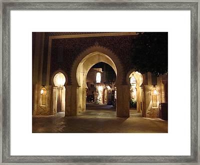 Archways At Night Framed Print by Kim  Chernecky