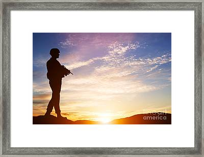 Armed Soldier With Rifle Standing And Looking On Horizon Framed Print by Michal Bednarek
