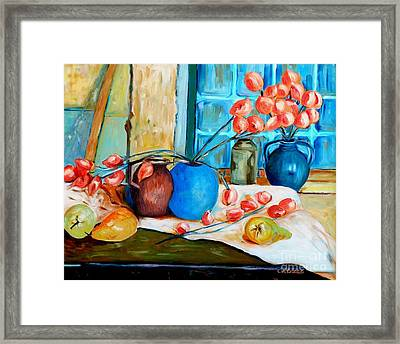 Arranging The Flowers Framed Print by Caroline Street