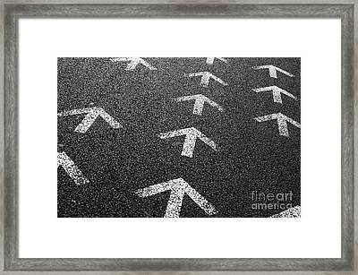 Arrows On Asphalt Framed Print