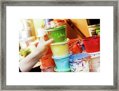 Artist Reaching For A Liquid Paint Container. Framed Print by Michal Bednarek