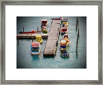 Colorful Fishing Boats Framed Print by Jean Marie Maggi