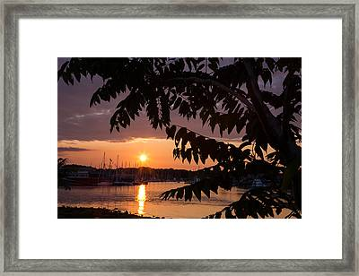 As It Sets Over The Harbor Framed Print
