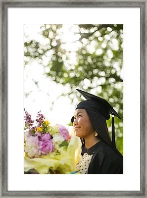 Asian Girl In Graduation Cap Framed Print