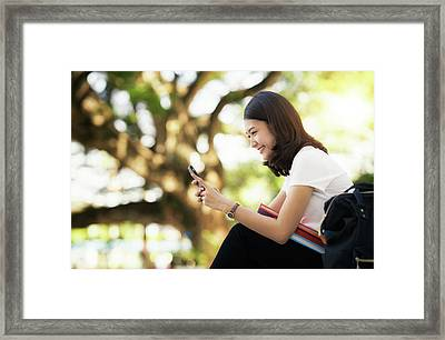 Asian Lady Relax With Mobile Smart Phone Framed Print