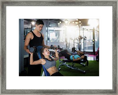 Asian Trainer And Lady Take Personal Training In Fitness Club Framed Print