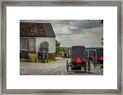 Assorted Amish Buggies At Barn Framed Print
