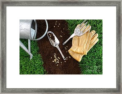Assortment Of Garden Tools On Earth Framed Print by Sandra Cunningham