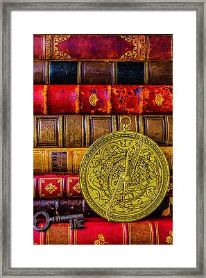 Astrolabe And Old Books Framed Print