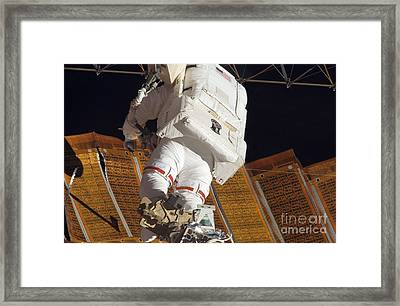 Astronaut Installs Stabilizers Framed Print by Stocktrek Images