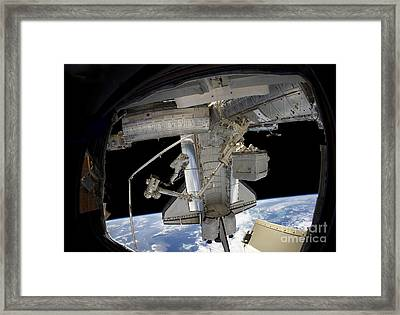 Astronaut Participates In A Spacewalk Framed Print