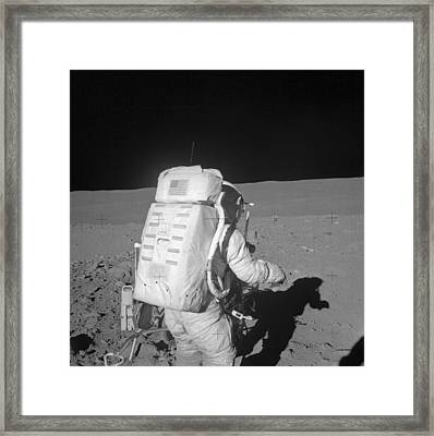 Astronaut Walking On The Moon Framed Print by Stocktrek Images