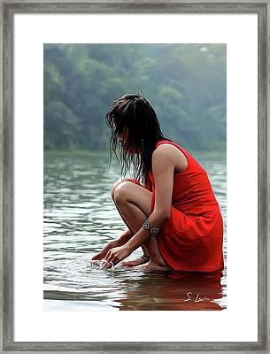 At A Lake Framed Print