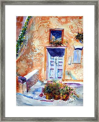 At Home In Santorini Greece  Framed Print