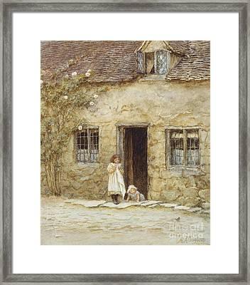 At The Cottage Door Framed Print by Helen Allingham
