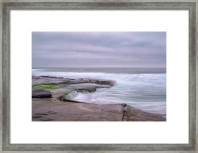 At The Edge Of The Sea Framed Print