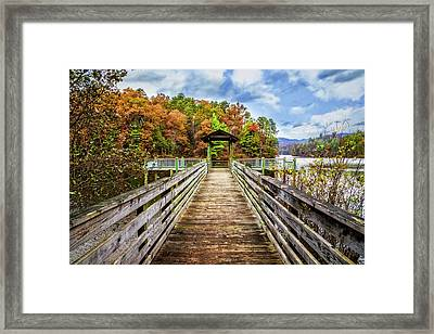At The End Of The Dock Framed Print by Debra and Dave Vanderlaan