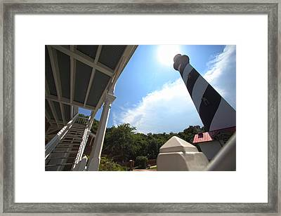 At The Light Framed Print