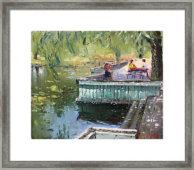 At The Park By The Water Framed Print by Ylli Haruni