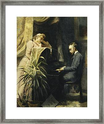 At The Piano Framed Print
