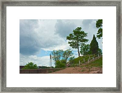 At The Wall Framed Print by Kendall Tabor