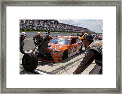 Athletic Mechanics Framed Print by Mark A Brown
