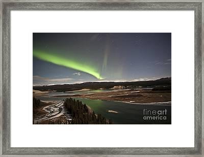 Aurora Borealis Over Yukon River Framed Print