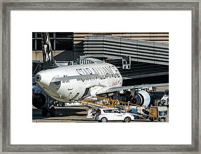 Austrian Star Alliance At Preparation Aircraft Befthe Gate Of Zurich Framed Print by Roberto Chiartano