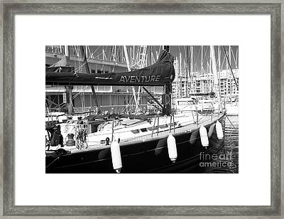 Aventure In Marseille Framed Print by John Rizzuto